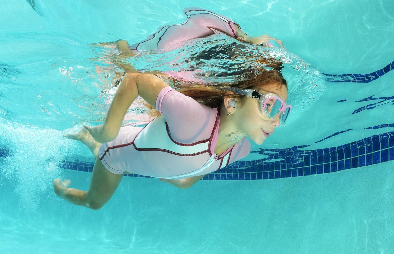 cute kid swimming in pool