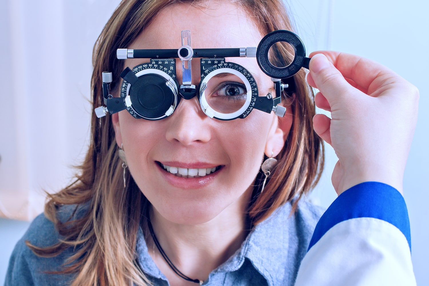 Girl in messbrille glasses in ophthalmology clinic